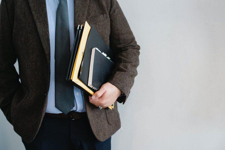 man holding documents