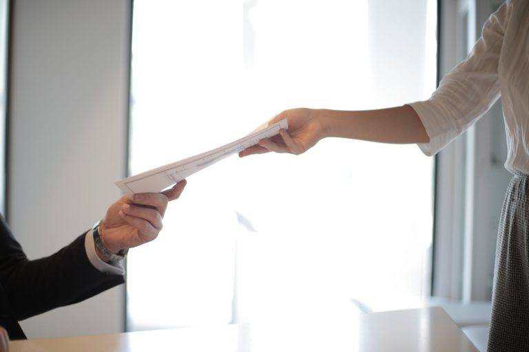 person handing a document