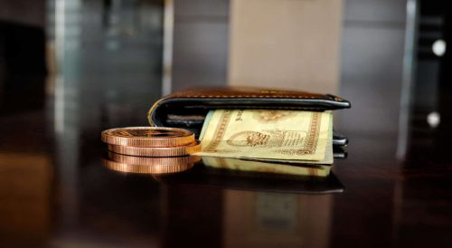 brown leather wallet with cash inside