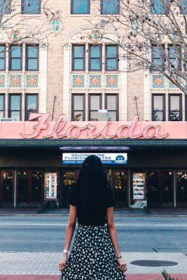 girl standing outside the Florida theater