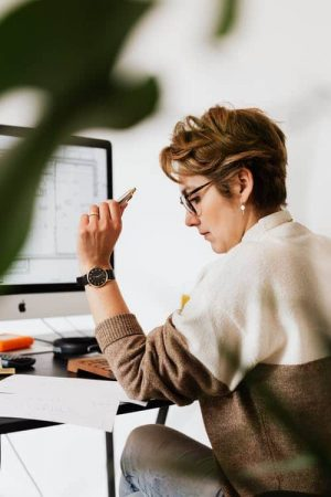 woman reading on desk