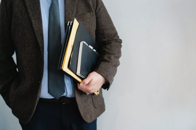 a guy holding documents