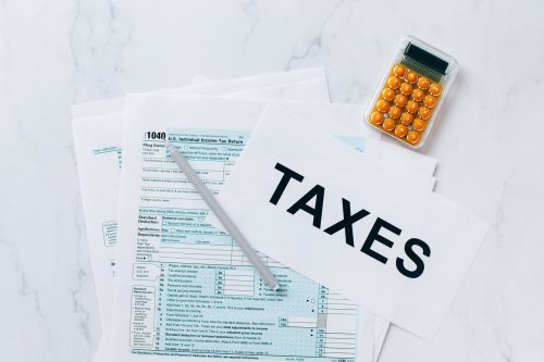 tax forms, pen, and calculator