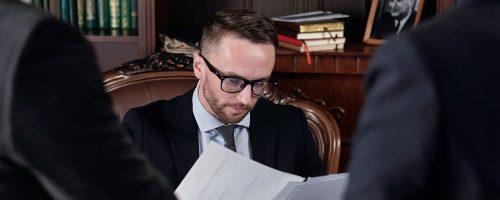 man browsing papers
